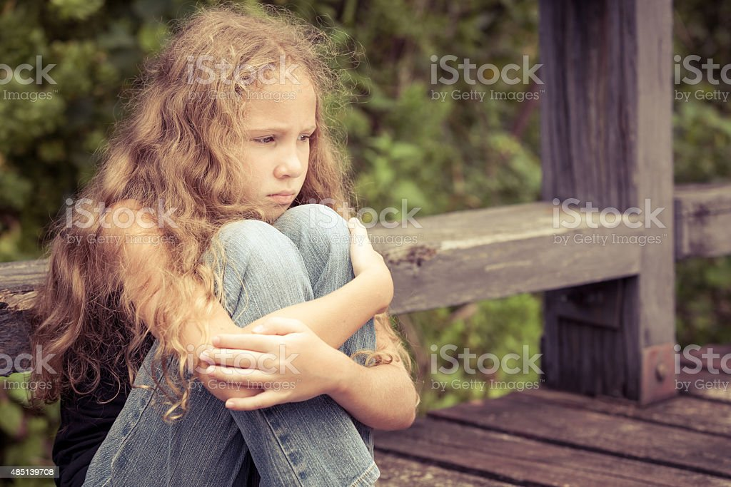 Portrait of sad blond teen girl stock photo