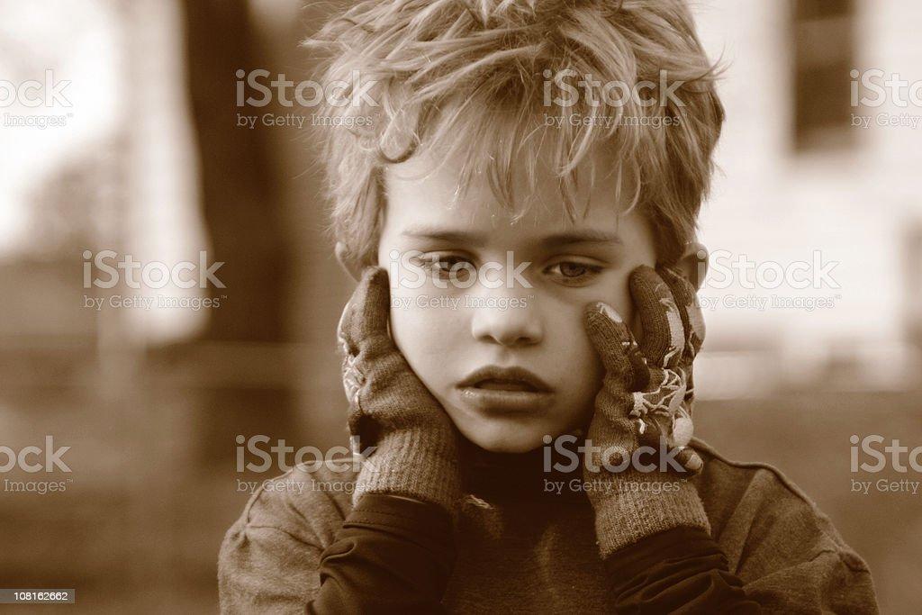 Portrait of Sad Little Boy Outside, Sepia Toned royalty-free stock photo