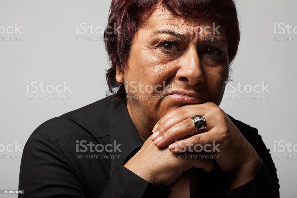Portrait of sad lonely pensive middle aged woman. stock photo