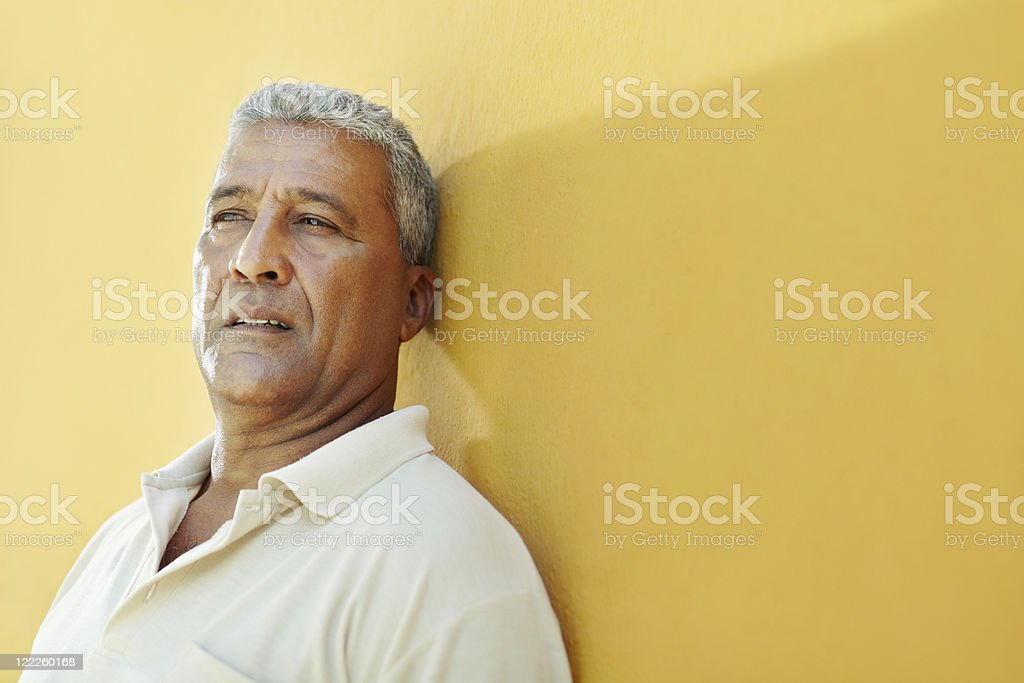 portrait of sad mature hispanic man stock photo