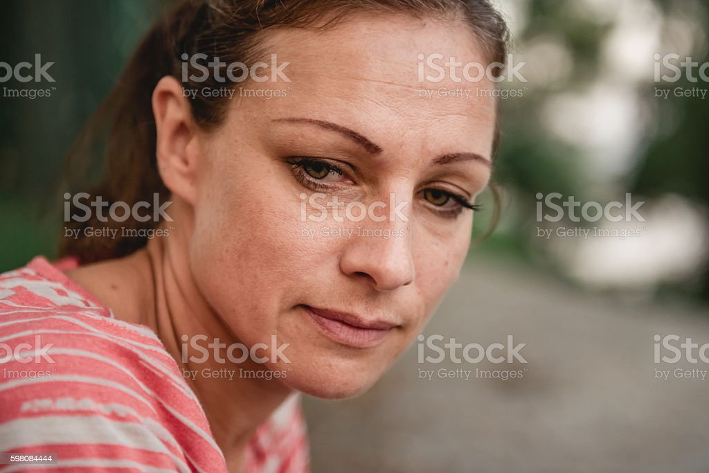 Portrait of sad woman stock photo