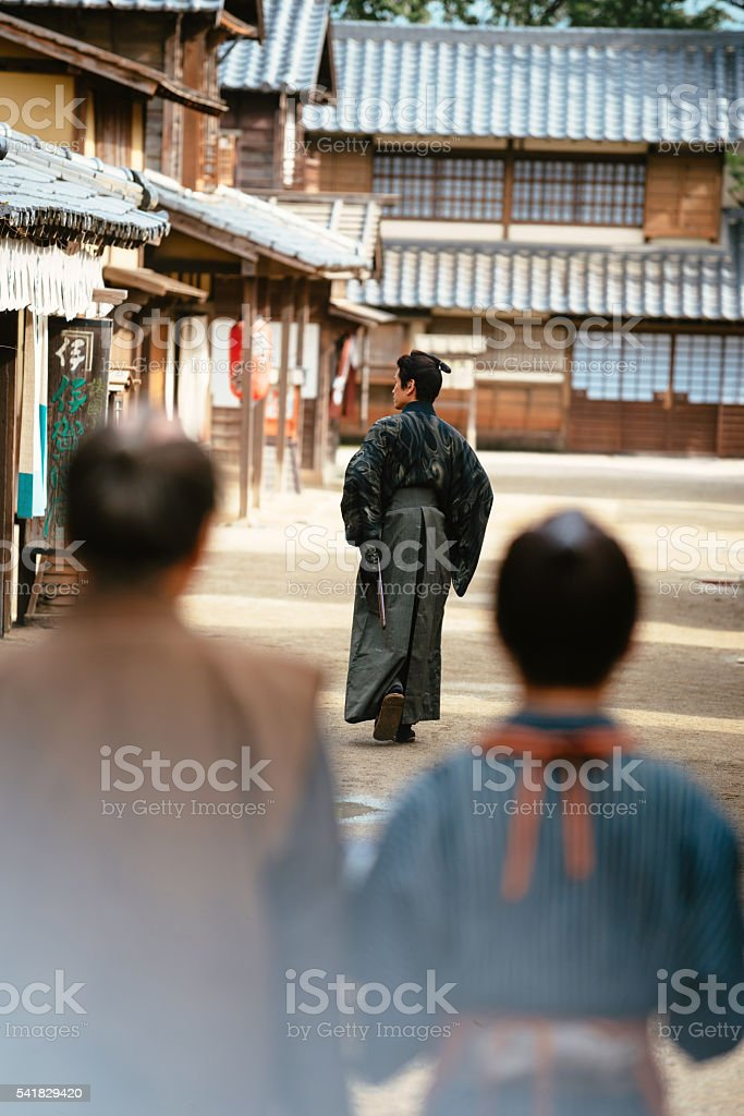 Portrait of samurai and peasants in traditional Japanese village stock photo