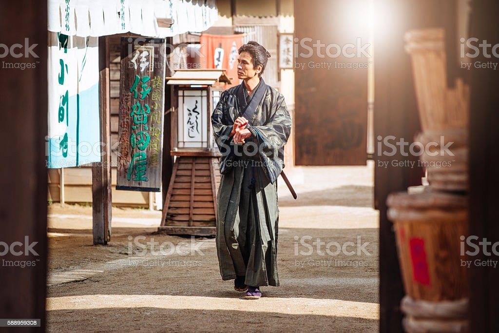 Portrait of samurai in traditional Japanese village stock photo