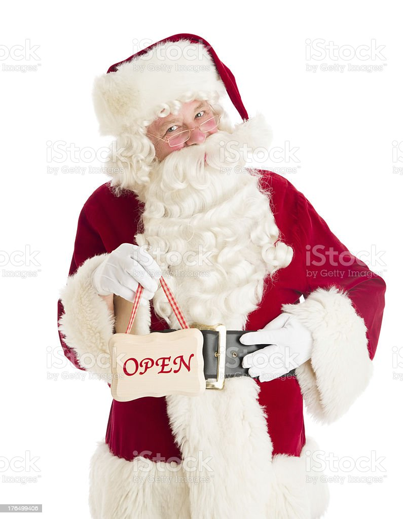 Portrait Of Santa Claus Holding Open Sign royalty-free stock photo
