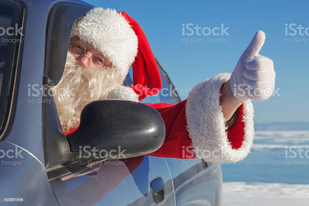 Portrait of Santa Claus in the car stock photo