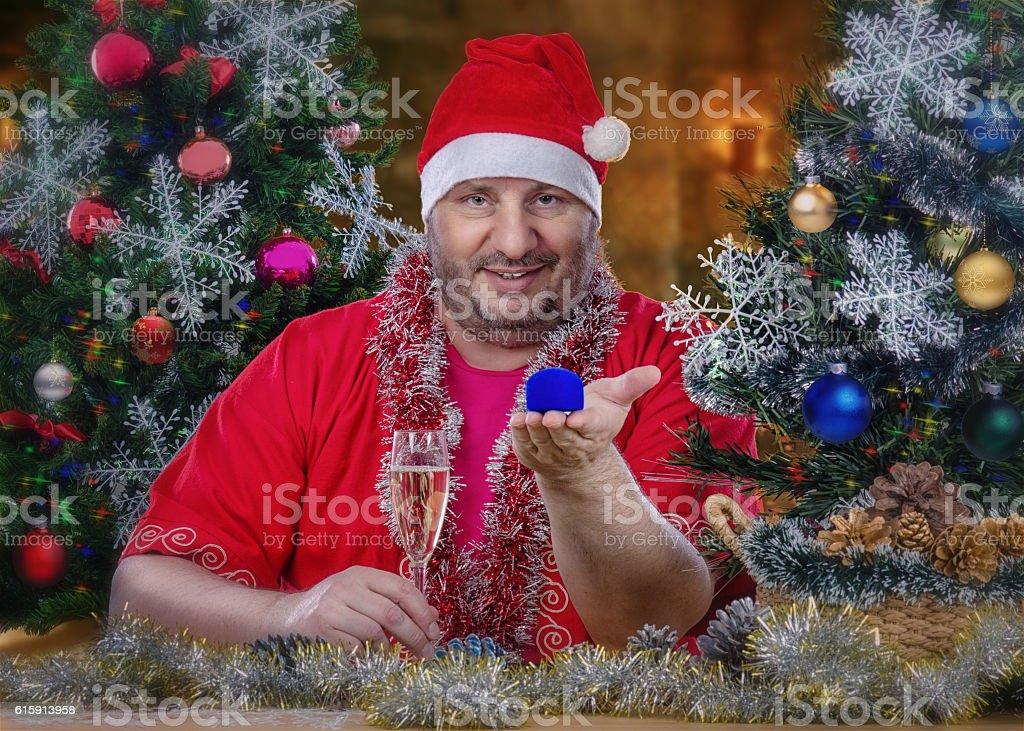 Portrait of Santa Claus with jewelry box stock photo