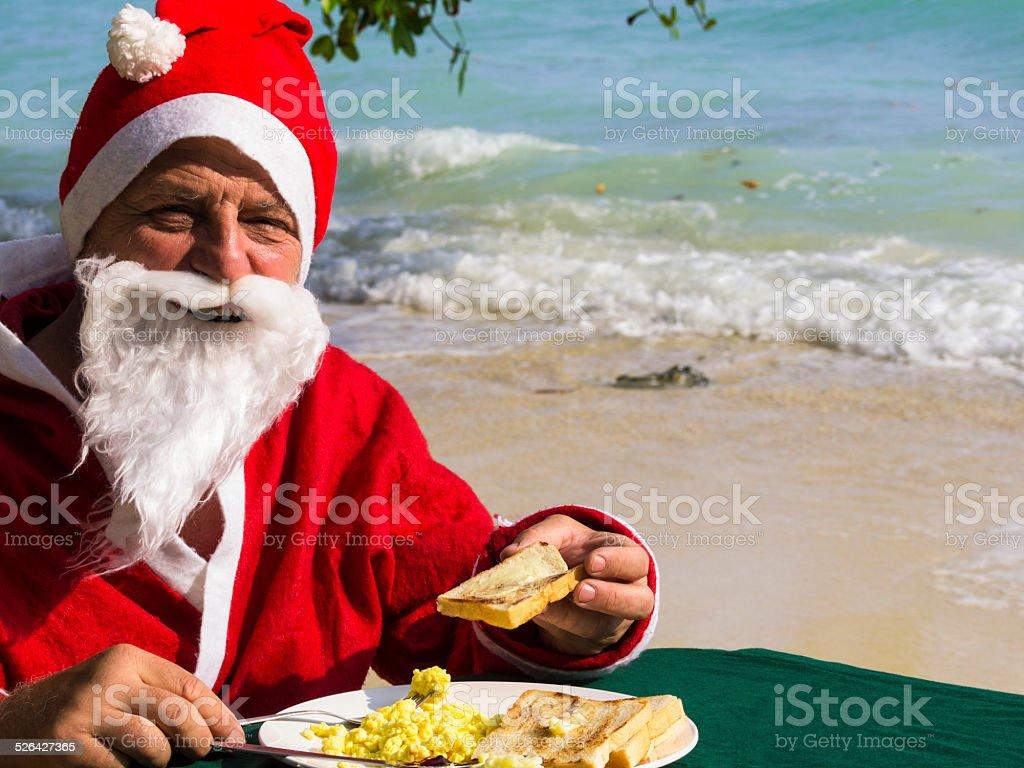 Portrait of Santa Cloaus  having Breakfast stock photo