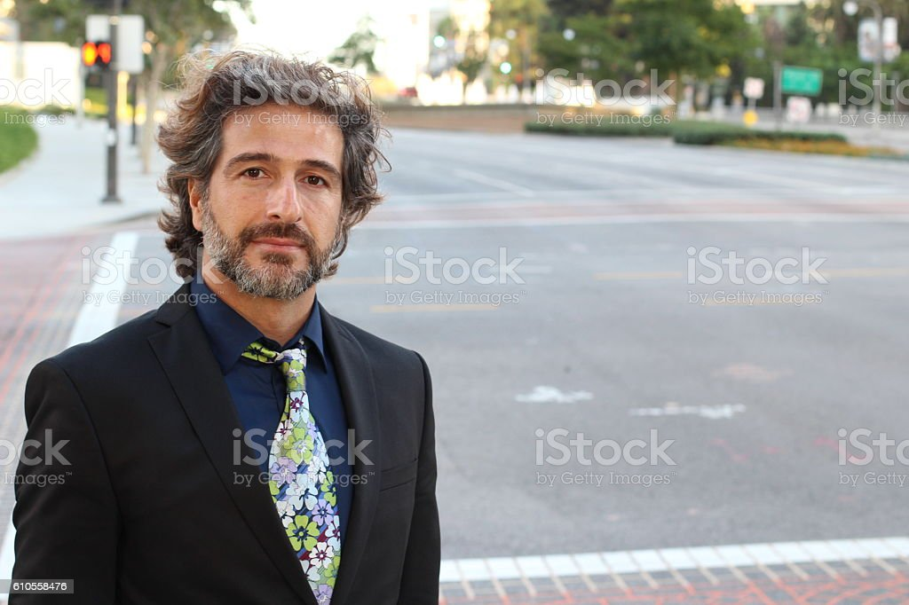 Portrait of satisfied looking business man stock photo