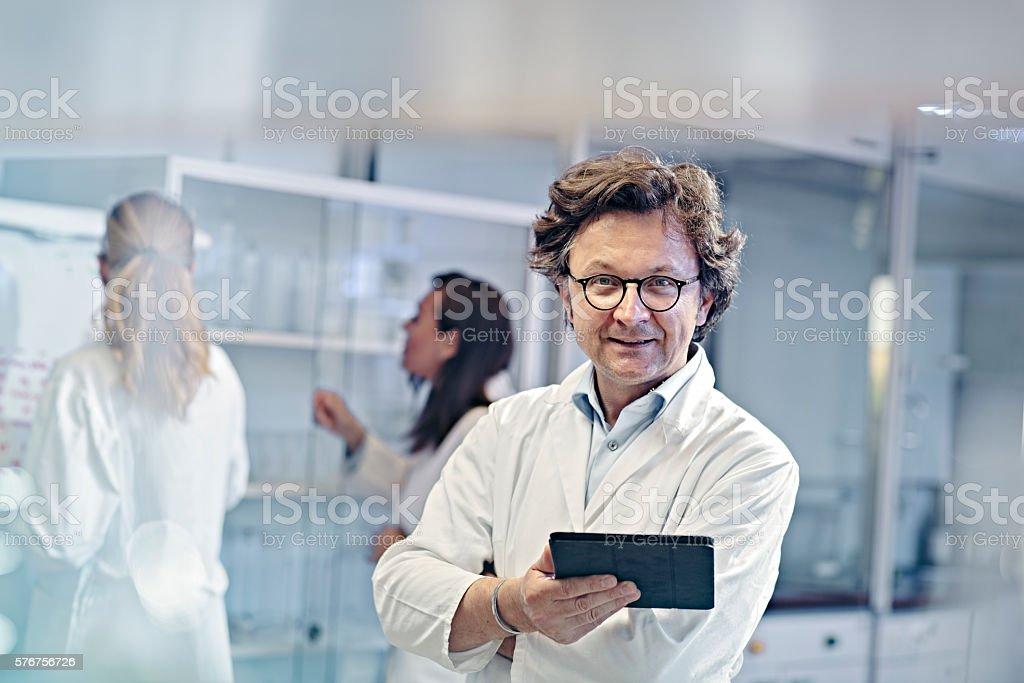 Portrait of scientist working in laboratory stock photo