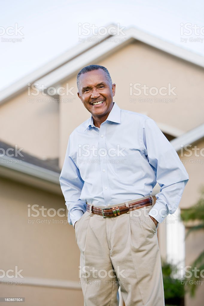Portrait of senior African American man standing outside house royalty-free stock photo