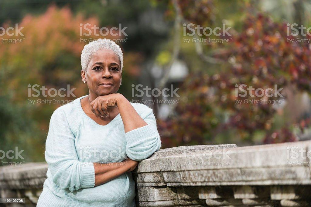 Portrait of senior black woman at the park stock photo