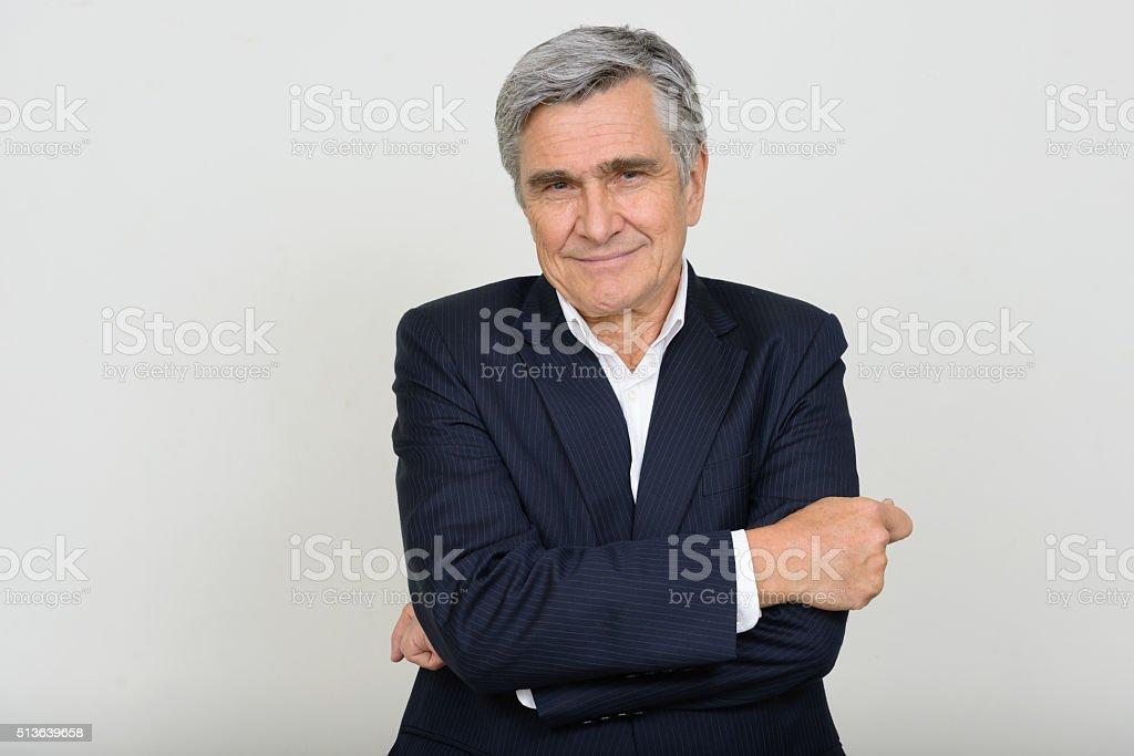 Portrait Of Senior Businessman Smiling stock photo
