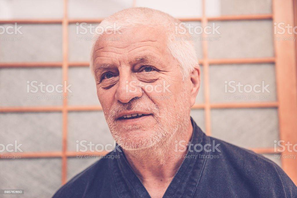 Portrait of Senior Caucasian Man in Buddhist Temple, Kyoto, Japan stock photo