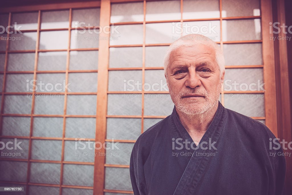 Portrait of Senior Caucasian Man in Buddhist Temple, Kyoto, Japan stock photo