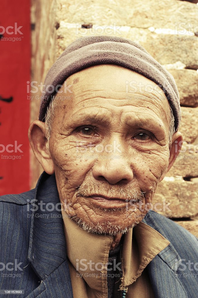 Portrait of Senior Chinese Man Outside Near Building royalty-free stock photo