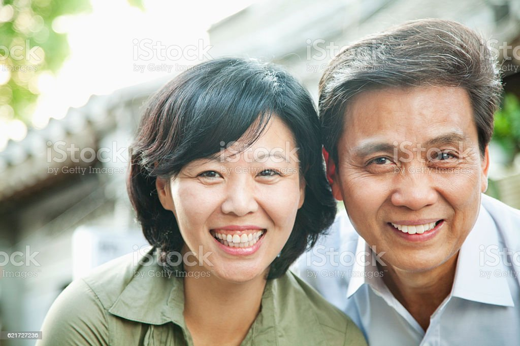 Portrait of senior couple in hutong stock photo