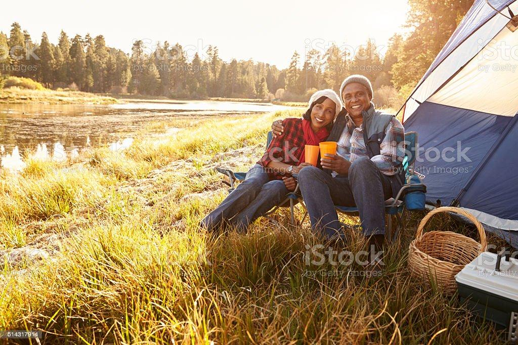 Portrait Of Senior Couple On Autumn Camping Trip stock photo