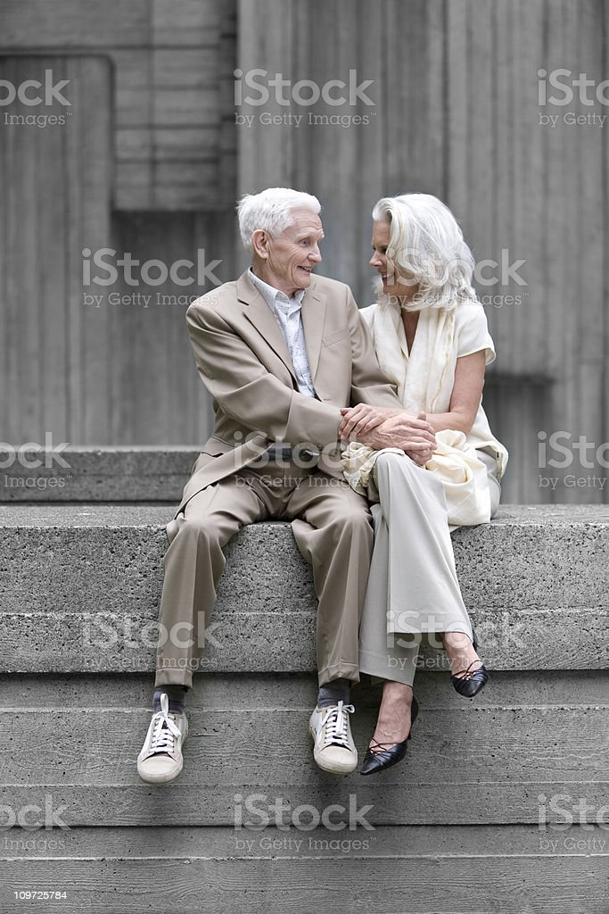 Portrait of Senior Couple Smiling and Holding Each Other stock photo