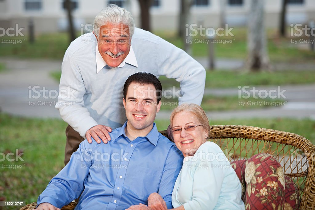 Portrait of senior couple with adult son stock photo