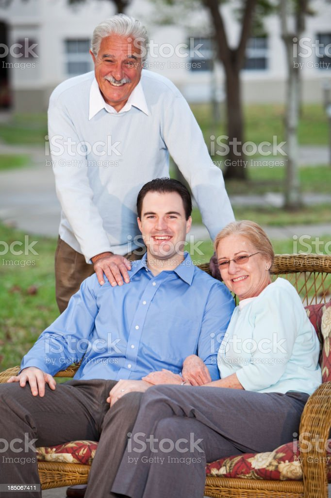 Portrait of senior couple with adult son royalty-free stock photo