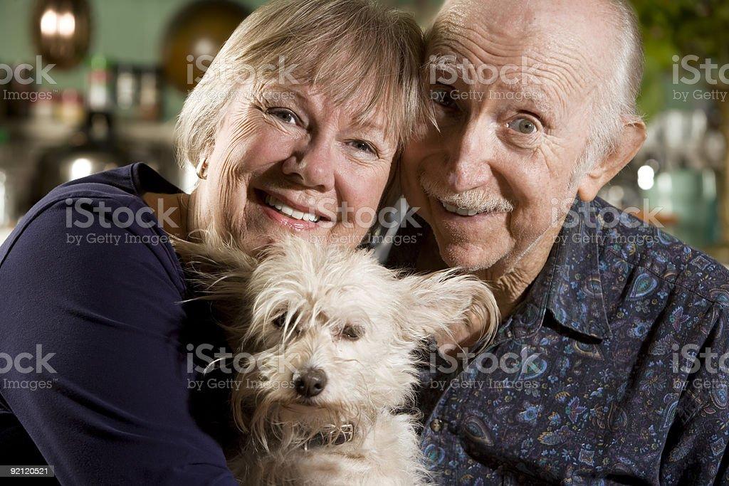 Portrait of Senior Couple with Dog royalty-free stock photo