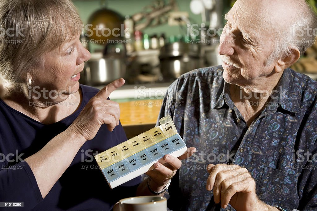 Portrait of Senior Couple with Pill Case royalty-free stock photo