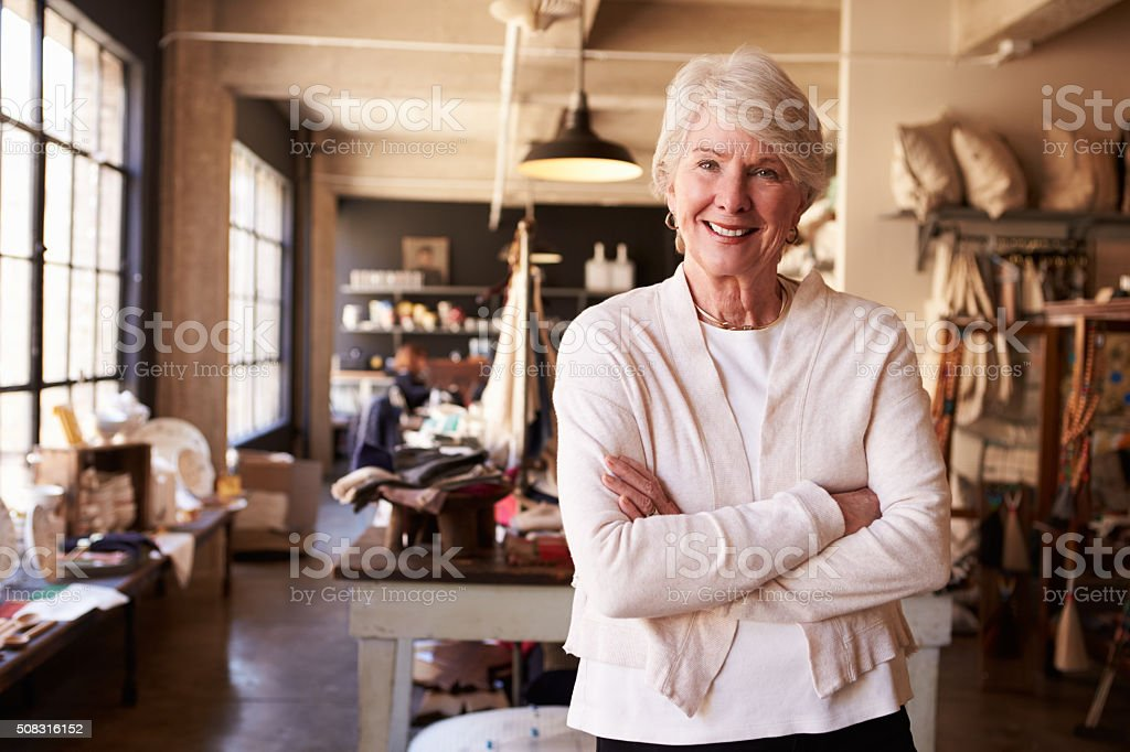 Portrait Of Senior Female Owner Of Gift Store stock photo