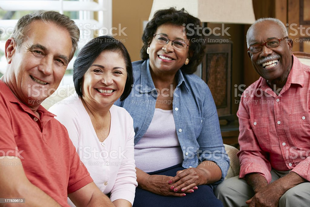 Portrait Of Senior Friends At Home Together stock photo