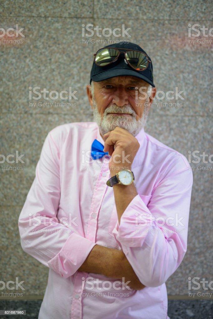Portrait of senior handsome man wearing stylish clothes inside MRT...