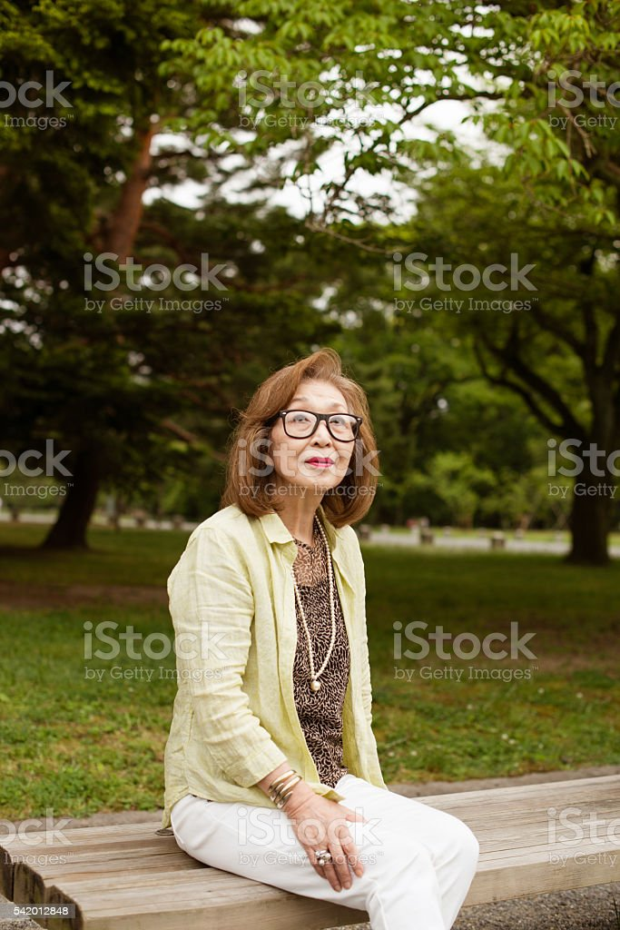 Portrait of senior Japanese woman with glasses stock photo