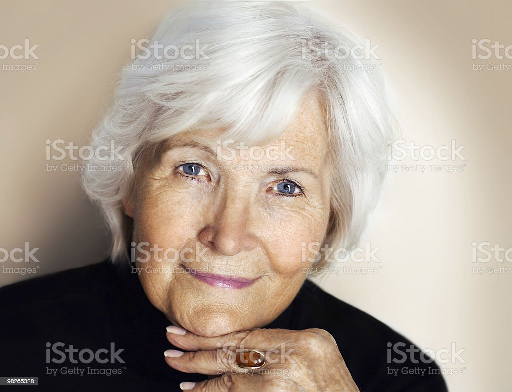Portrait of senior lady with grey hair and blue eyes royalty-free stock photo