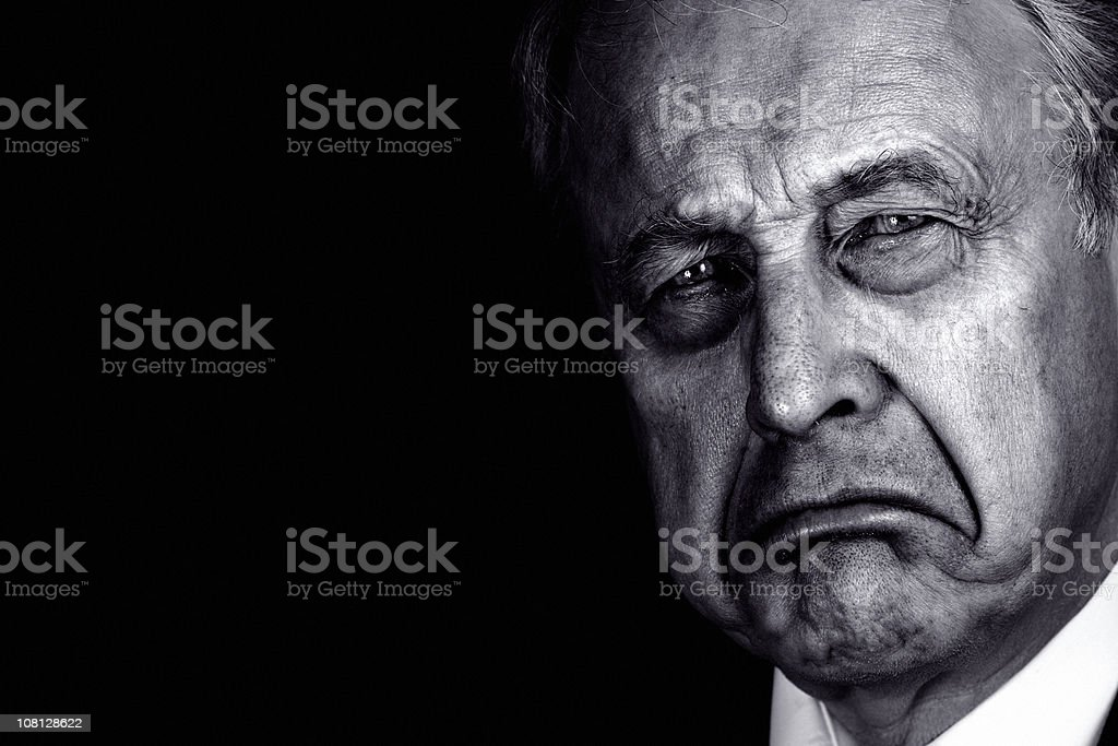 Portrait of Senior Man Frowning, Black and White stock photo