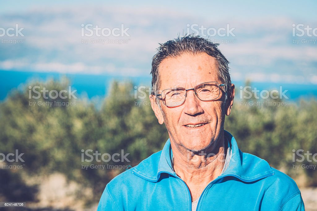 Portrait of Senior Man Harvesting Olives in Brac, Croatia, Europe stock photo