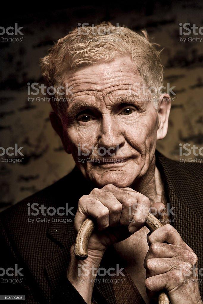 Portrait of Senior Man Holding Cane royalty-free stock photo