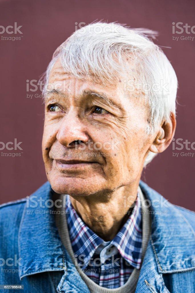 Portrait of senior man, looking away stock photo