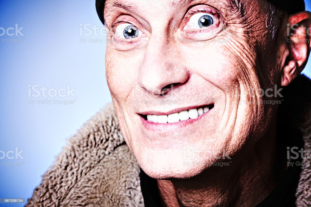 Portrait of senior man smiling with twinkling eyes stock photo