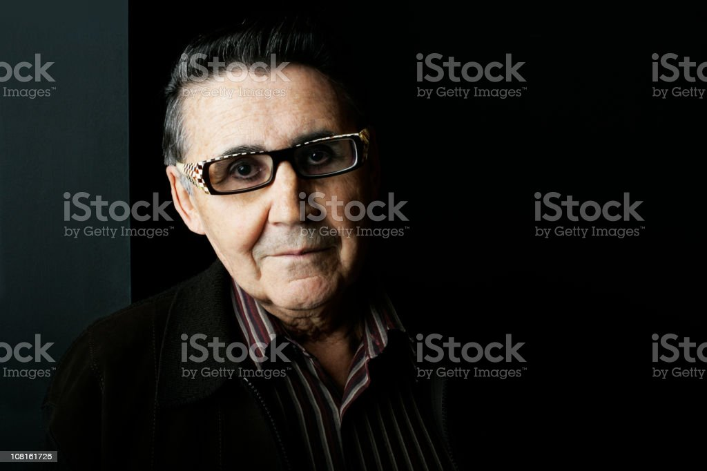 Portrait of Senior Man Wearing Contemporary Glasses royalty-free stock photo