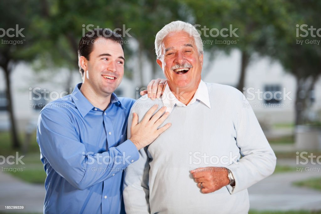Portrait of senior man with adult son stock photo