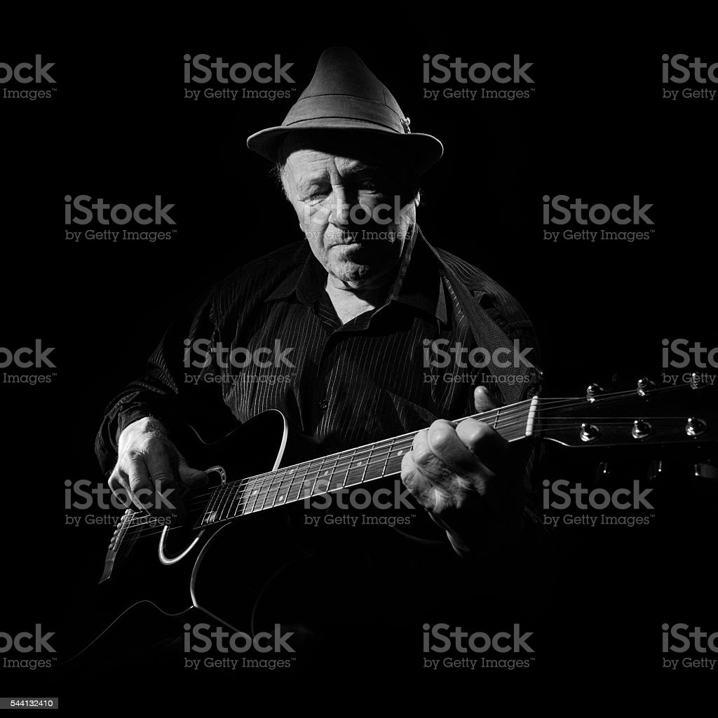 Portrait of senior man with guitar. stock photo