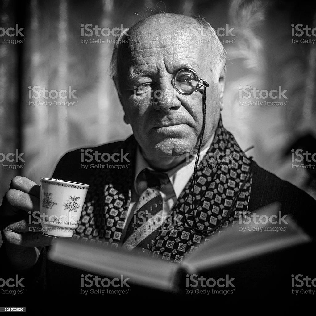Portrait of Senior Man with monocle. stock photo