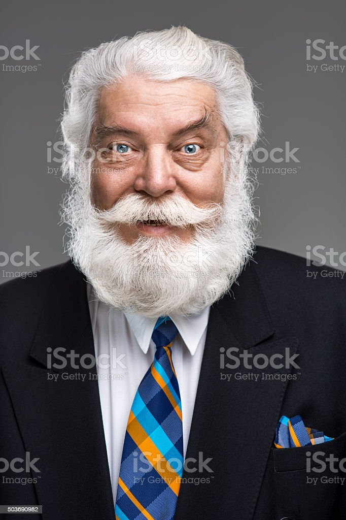 Portrait of senior man with white beard and mustache smiling stock photo