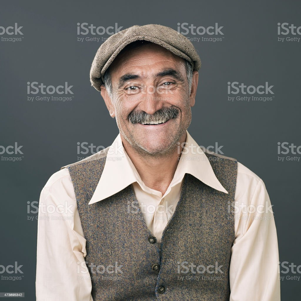 Portrait Of Senior Wearing A Flat Newsboy Cap And Smiling stock photo