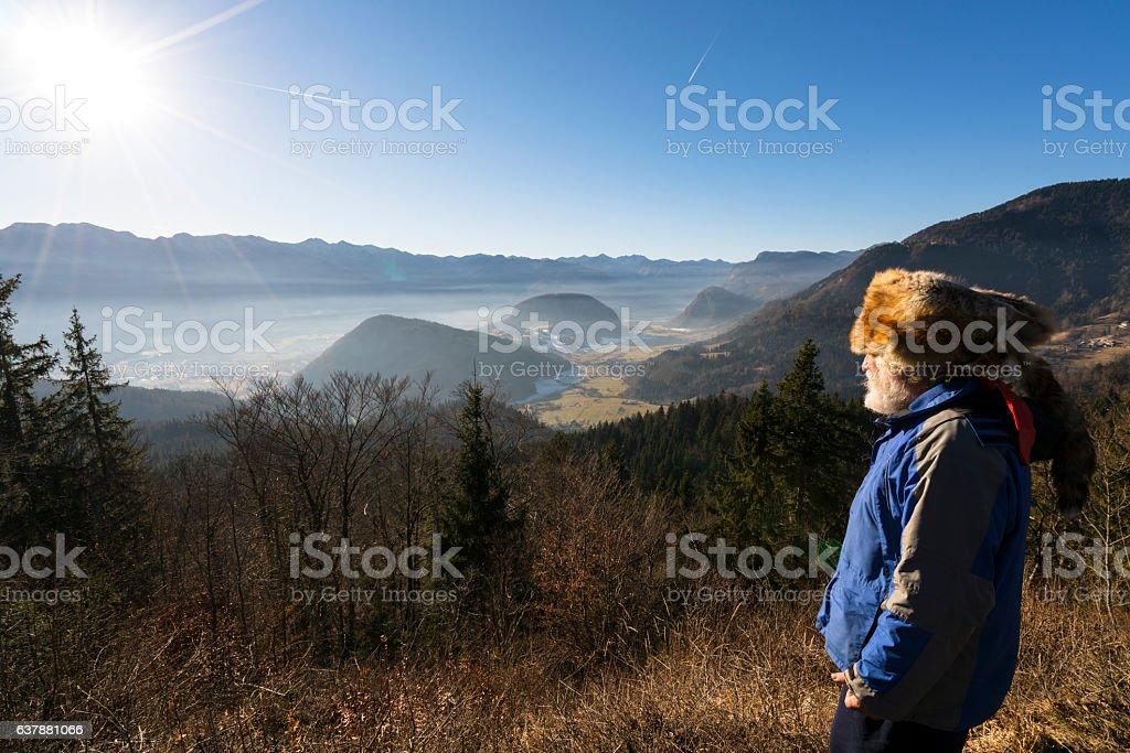 Portrait of senior with Kuchma on mountain's sun shine stock photo