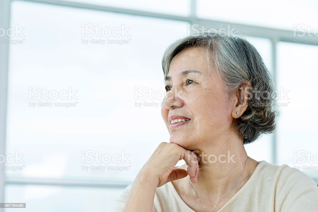 Portrait of senior woman at home stock photo