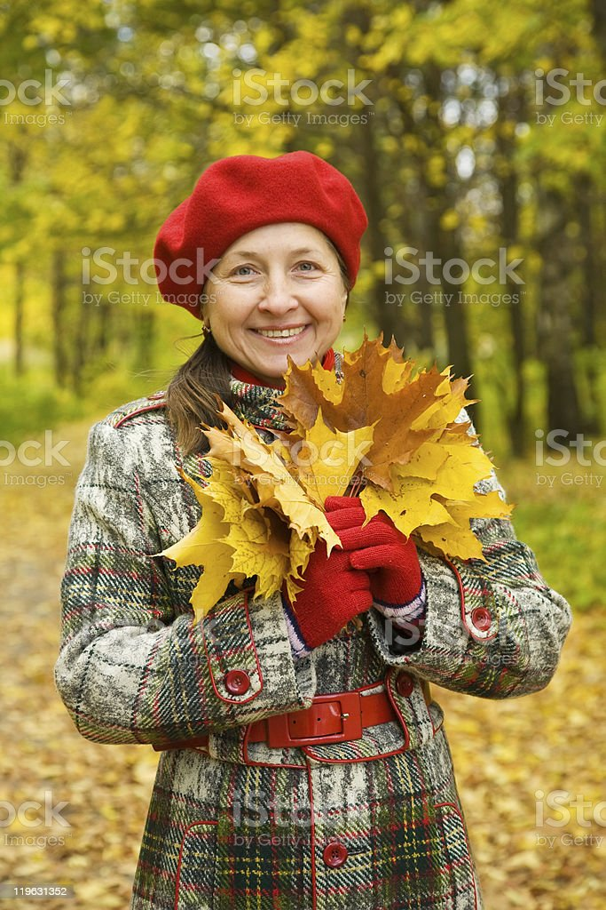 Portrait of senior woman  in autumn royalty-free stock photo