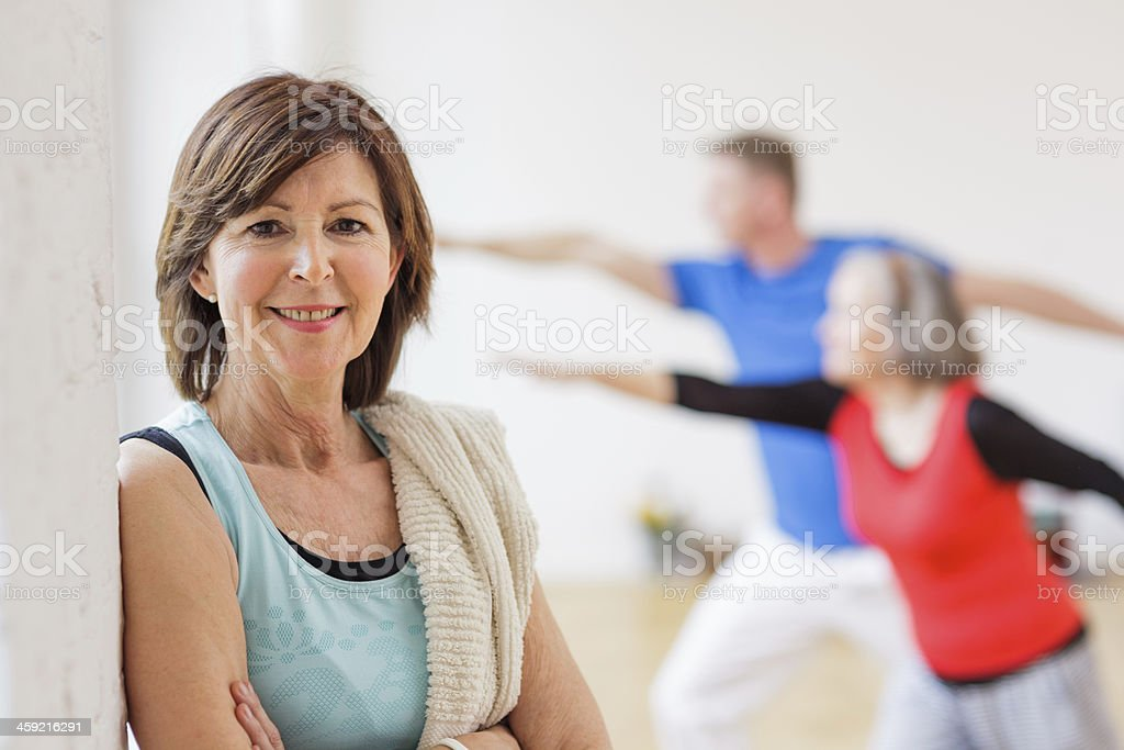 Portrait of Senior Woman in Yoga Class stock photo