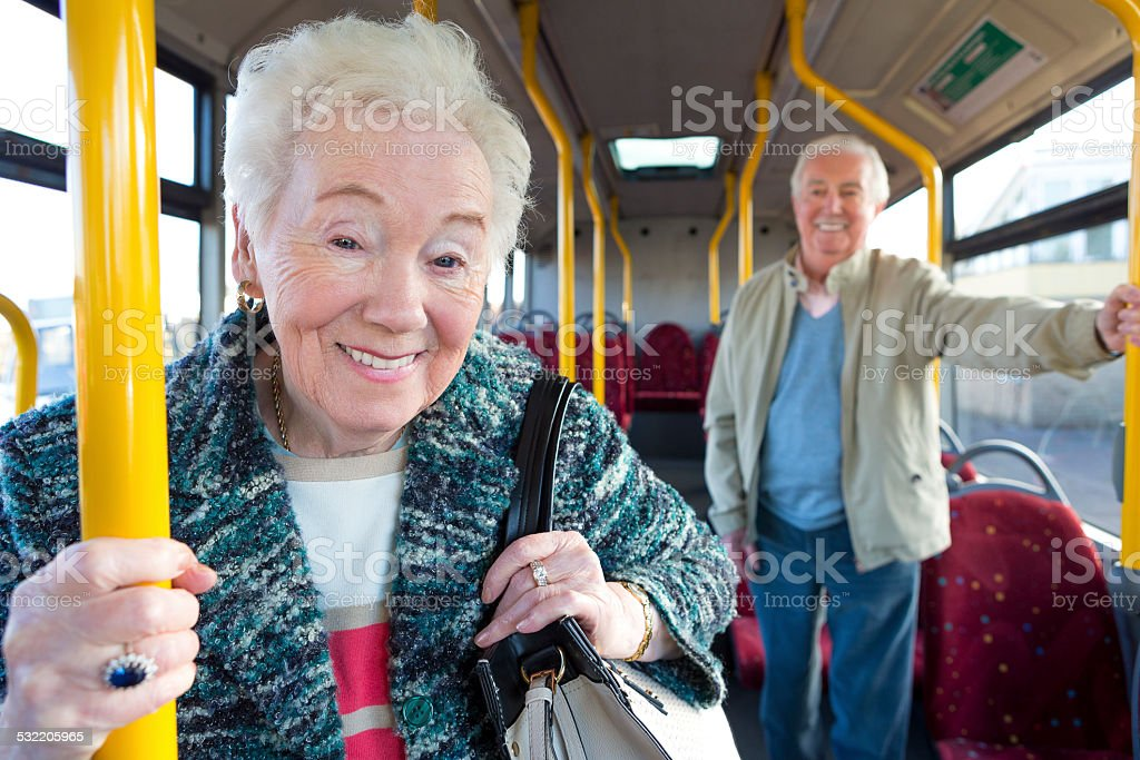 Portrait of Senior Woman on Bus stock photo