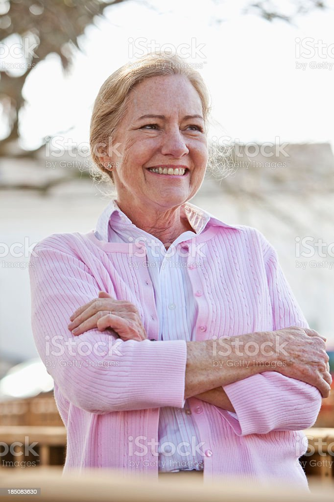 Portrait of senior woman outdoors stock photo