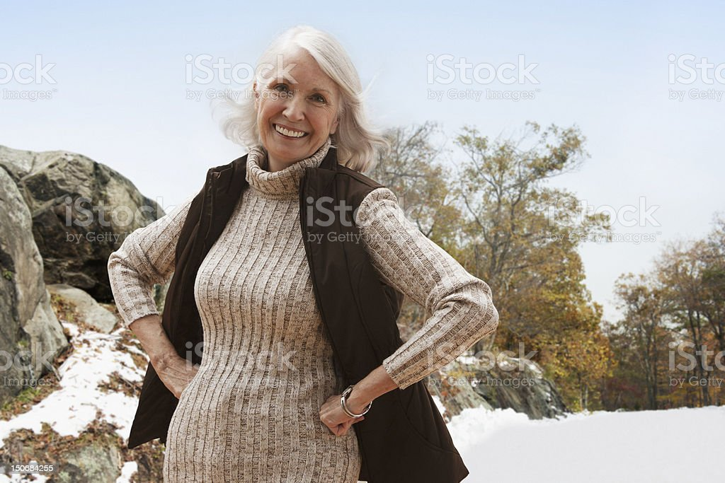 Portrait of senior woman outdoors with hands on hips royalty-free stock photo