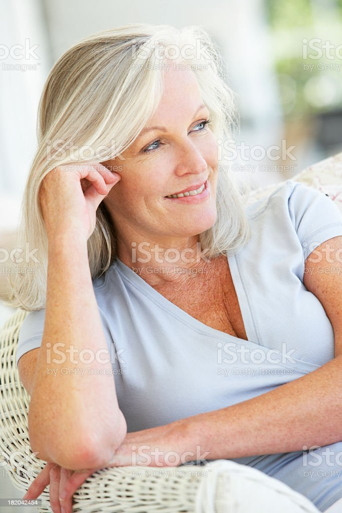 Portrait Of Senior Woman Relaxing In Chair royalty-free stock photo